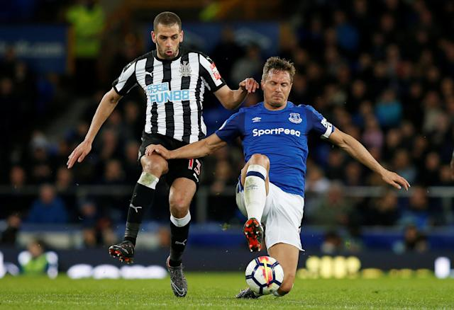 "Soccer Football - Premier League - Everton v Newcastle United - Goodison Park, Liverpool, Britain - April 23, 2018 Everton's Phil Jagielka in action with Newcastle United's Islam Slimani REUTERS/Andrew Yates EDITORIAL USE ONLY. No use with unauthorized audio, video, data, fixture lists, club/league logos or ""live"" services. Online in-match use limited to 75 images, no video emulation. No use in betting, games or single club/league/player publications. Please contact your account representative for further details."