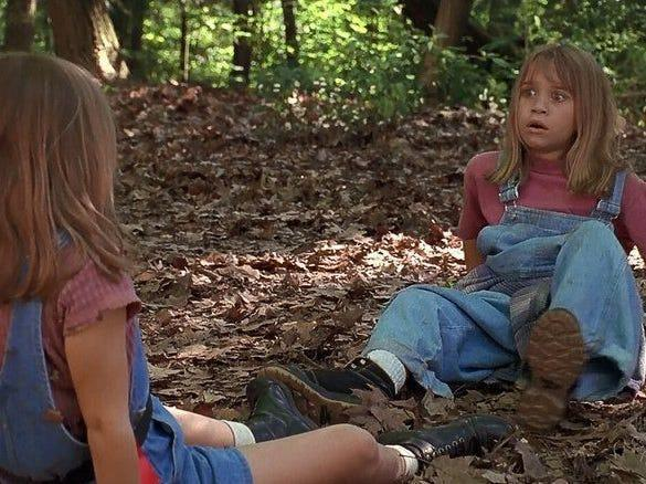 """Mary-Kate and Ashley Olsen in """"It Takes Two"""" on the ground in the woods"""