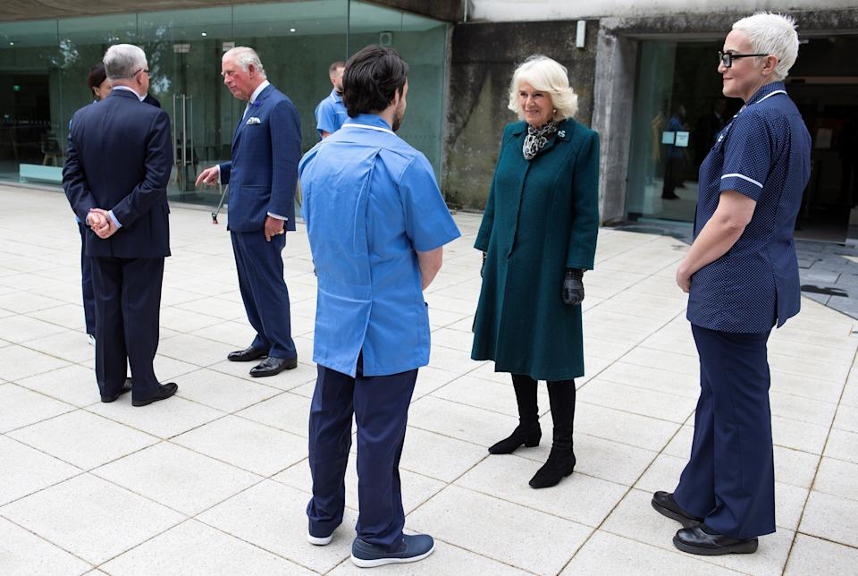 Britain's Prince Charles, Prince of Wales (2L) and his wife Britain's Camilla, Duchess of Cornwall (2R) meet with nurses and midwives from Belfast Health and Social Care Trust, who transitioned early from Queen's University Belfast and the Open University, into clinical roles to support and respond to the COVID-19 pandemic, during their visit to the Ulster Museum in Belfast on September 30, 2020. (Photo by Ian Vogler / POOL / AFP) (Photo by IAN VOGLER/POOL/AFP via Getty Images)