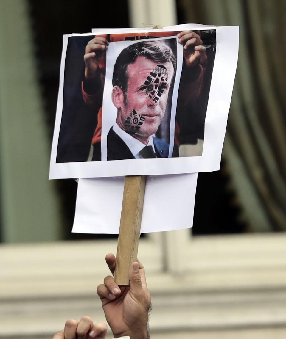 <p>Protesters carried signs of French president Emmanuel Macron</p>PA