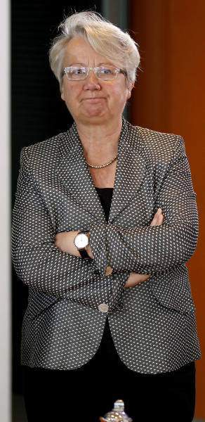 """FILE - In this May 9, 2012 file photo German Science Minister Annette Schavan waits for the beginning of the weekly cabinet meeting at the chancellery in Berlin, Germany. Schavan says she will not resign after a university stripped her of her doctorate because of plagiarism, and vowed to fight the ruling. Speaking on a trip to South Africa on Wednesday, Feb. 6, 2013, Schavan said she """"will not accept"""" the school's decision and would take legal action against it. (AP Photo/Michael Sohn, File)"""