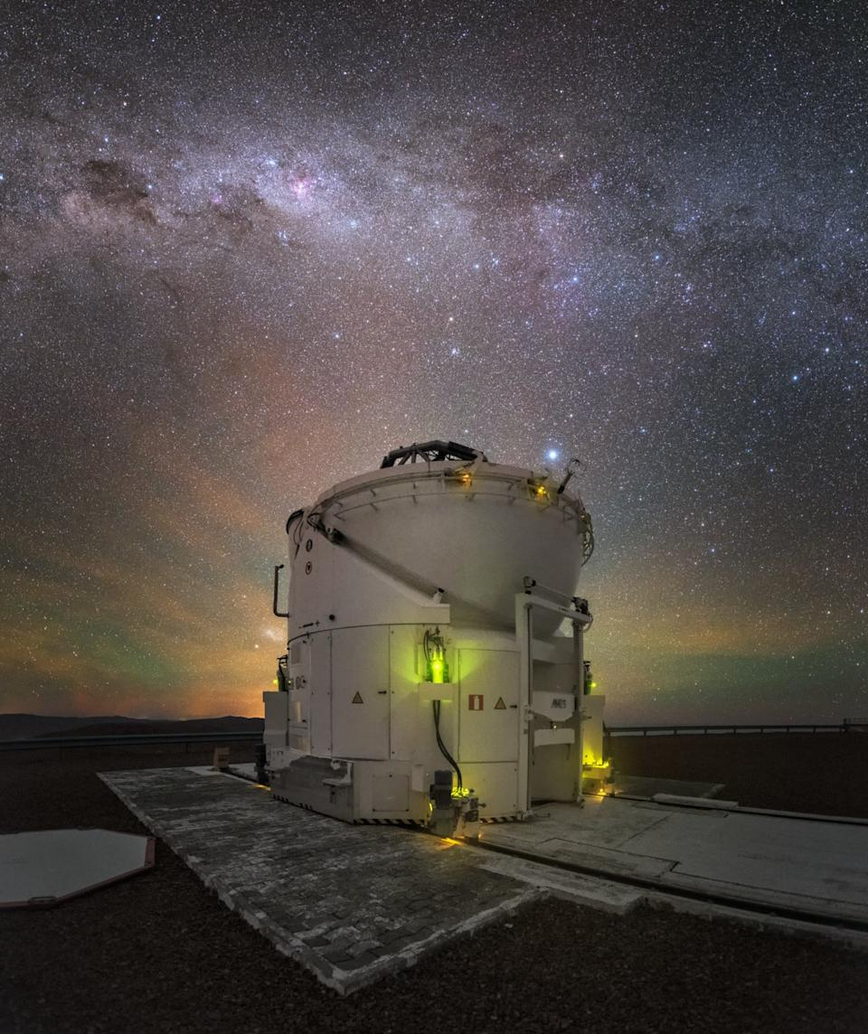 Green and yellow airglow topped with the shimmering core of the Milky Way galaxy provide a beautiful backdrop for a telescope at the Paranal Observatory in Chile in this image by European Southern Observatory (ESO) astrophotographer Yuri Beletsky. The telescope pictured here is one of four small auxiliary telescopes for ESO's Very Large Telescope array.