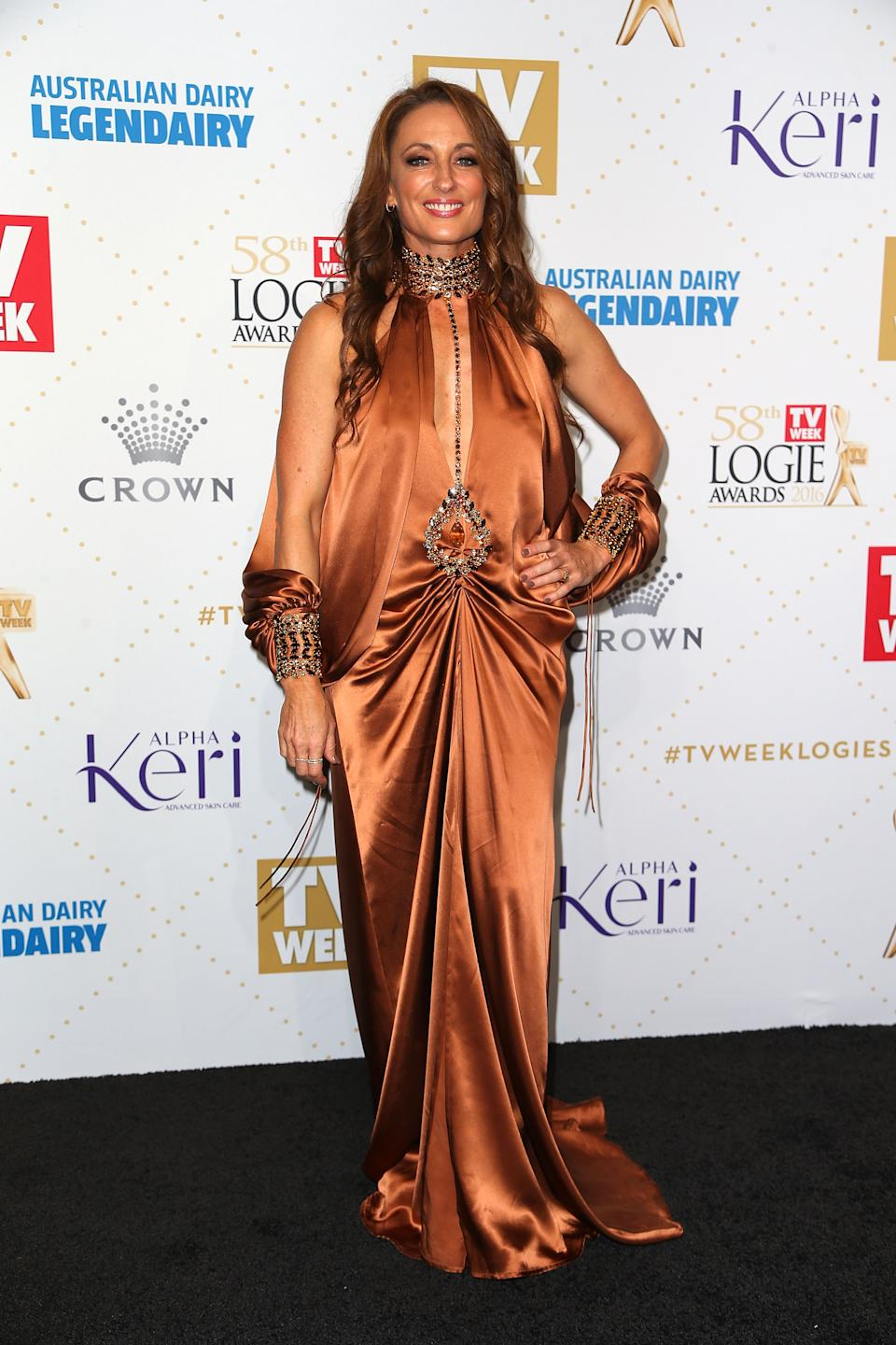Actor Georgie Parker's attempt at boho babe was sadly more boho blunder at the 2016 awards. Perhaps without the spliced sleeves and faux-choker neckline the terracotta gown may have passed the mustard but as it is, there's just too much going on. Ruching at the waist flatters no one, including glowing Georgie. Photo: Getty Images.
