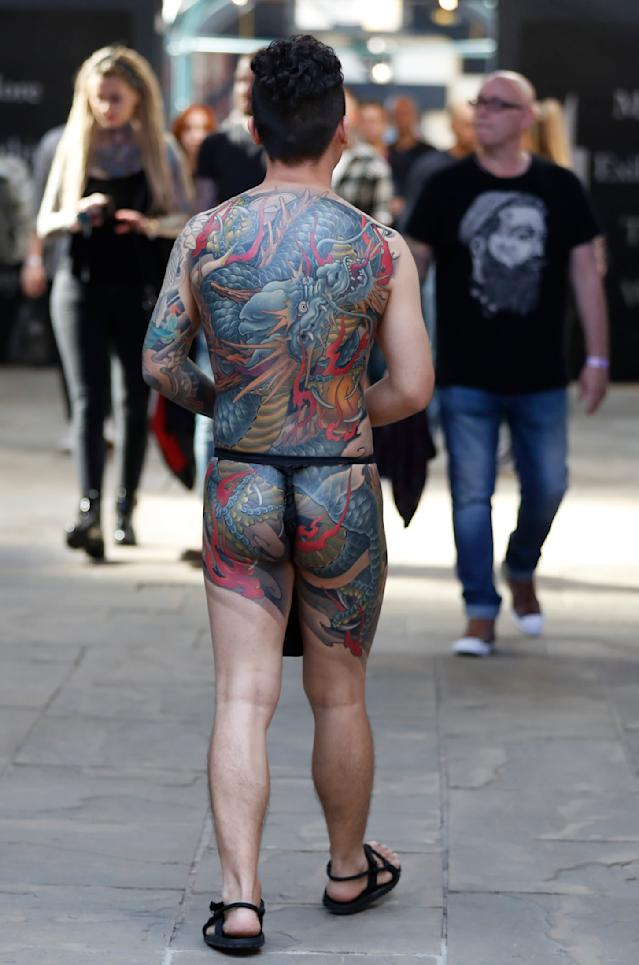 <p>A visitor displays his tattoos at The International Tattoo Convention in London, Friday, Sept. 22, 2017. (Photo: Kirsty Wigglesworth/AP) </p>