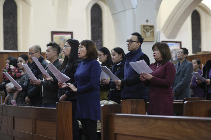 Worshippers pray during a Mass and vigil for the 39 victims found dead inside the back of a truck in Grays, Essex, at The Holy Name and Our Lady of the Sacred Heart Church, east London's Vietnamese church on Saturday, Nov. 2, 2019. All those killed were Vietnamese nationals, British police said. (Yui Mok/PA via AP)