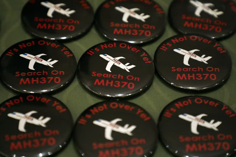 Badges are displayed during the sixth annual remembrance event for the missing Malaysia Airlines flight MH370 in Putrajaya