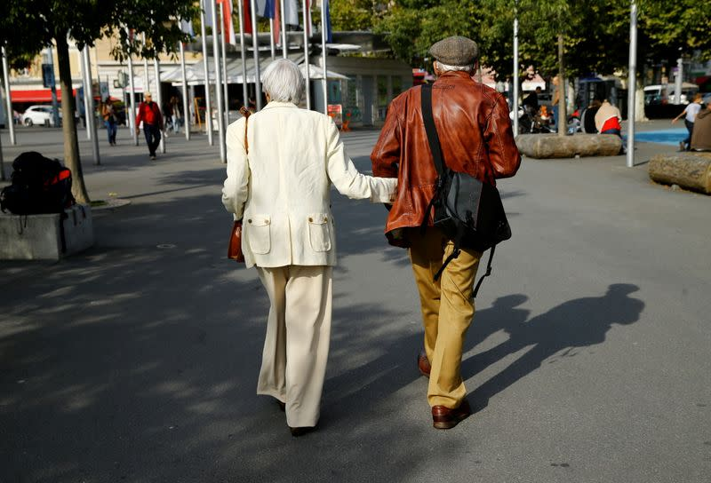 FILE PHOTO: Elderly people walk in the street ahead of a national vote on pensions reform in Lausanne