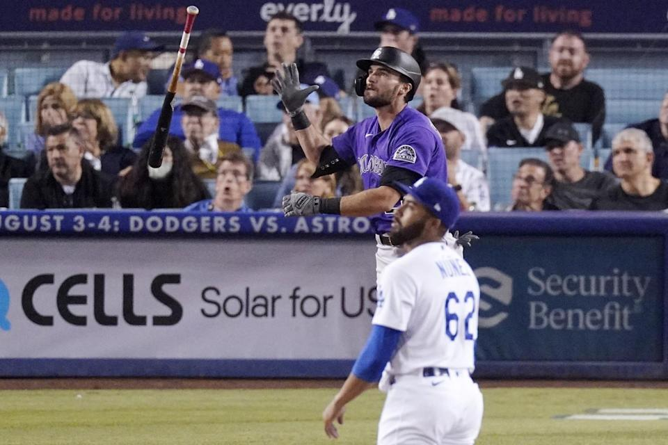 The Rockies' Sam Hilliard tosses his bat after hitting a ninth-inning solo homer off Dodgers reliever Darien Núñez.