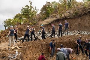 Residents of the Makawanpur District of Nepal work hand-in-hand with doTERRA Wellness Advocates on a water supply project that will serve approximately 2,500 people.
