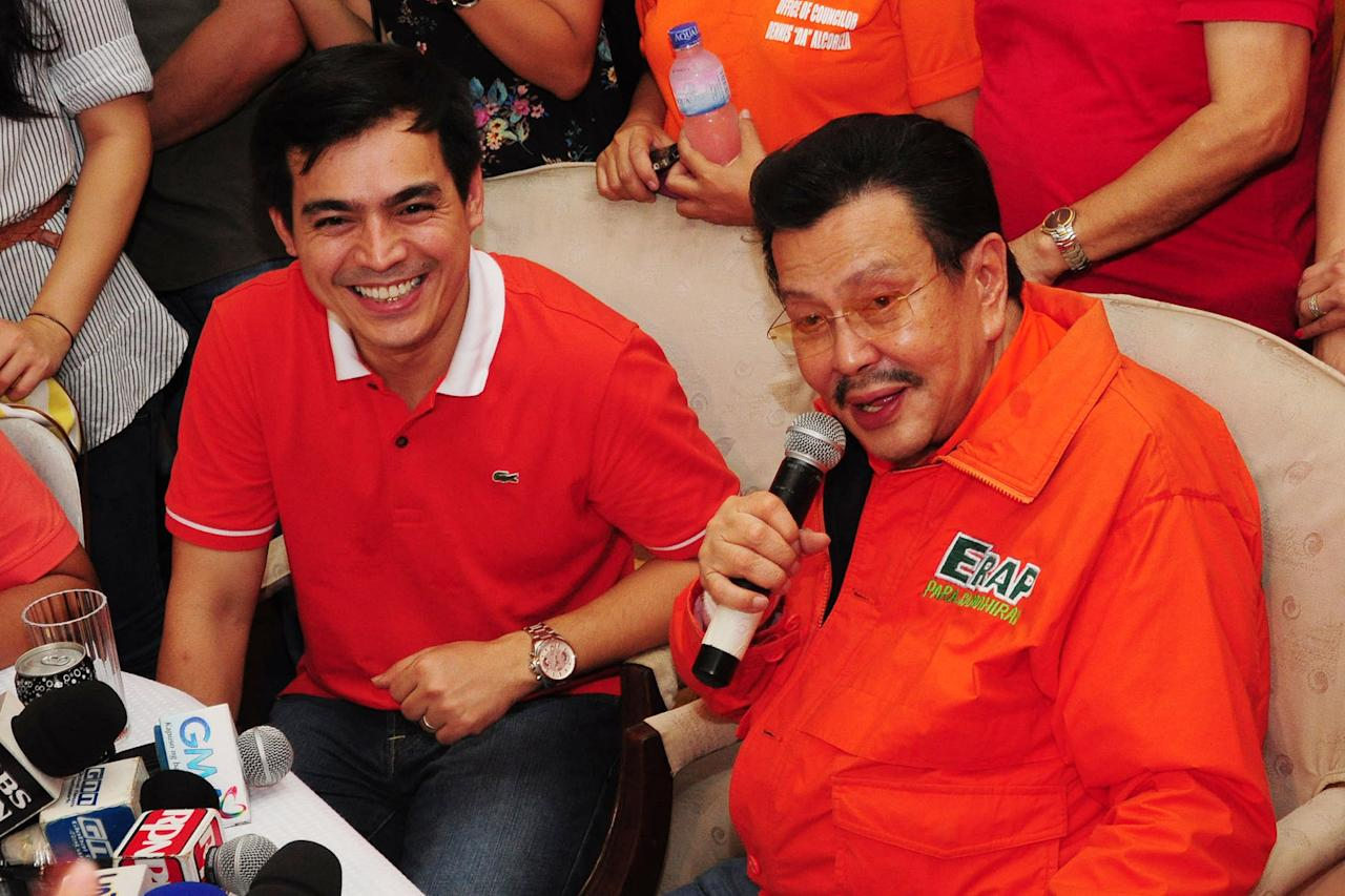Former Philippines President Joseph Estrada with Manila Vice Mayor Isko Moreno rode a jeep from San Juan City to Estrada's new residence in Sta. Mesa, Manila, on 09 May 2012. (George Calvelo/NPPA Images)