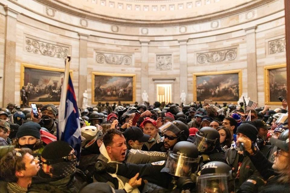 Police intervene after supporters of President Donald Trump breached security and entered the Capitol building in Washington, D.C., on Jan. 6. (Photo: Anadolu Agency via Getty Images)