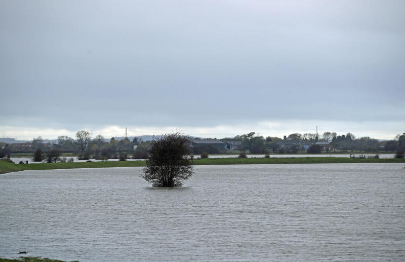 Large swathes of land are inundated by floodwater after days of heavy rain near Fishlake in Doncaster, England, Tuesday Nov. 12, 2019. Britain's Prime Minister Boris Johnson is set to chair a Government emergency committee meeting after severe flooding in parts of the country. (Danny Lawson/PA via AP)