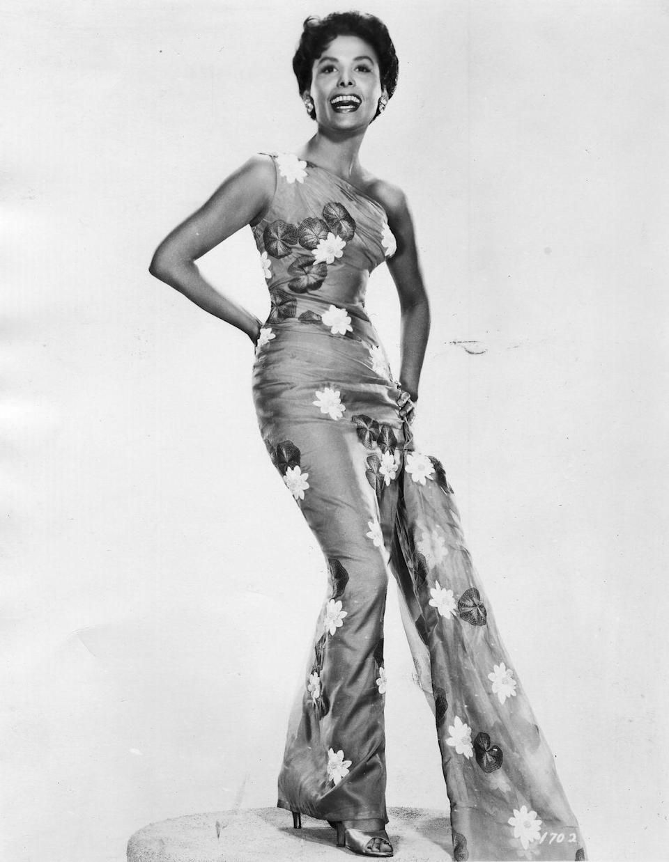 <p>The iconic Lena Horne posing in a floral-appliqué jumpsuit with a one-shouldered neckline. </p>