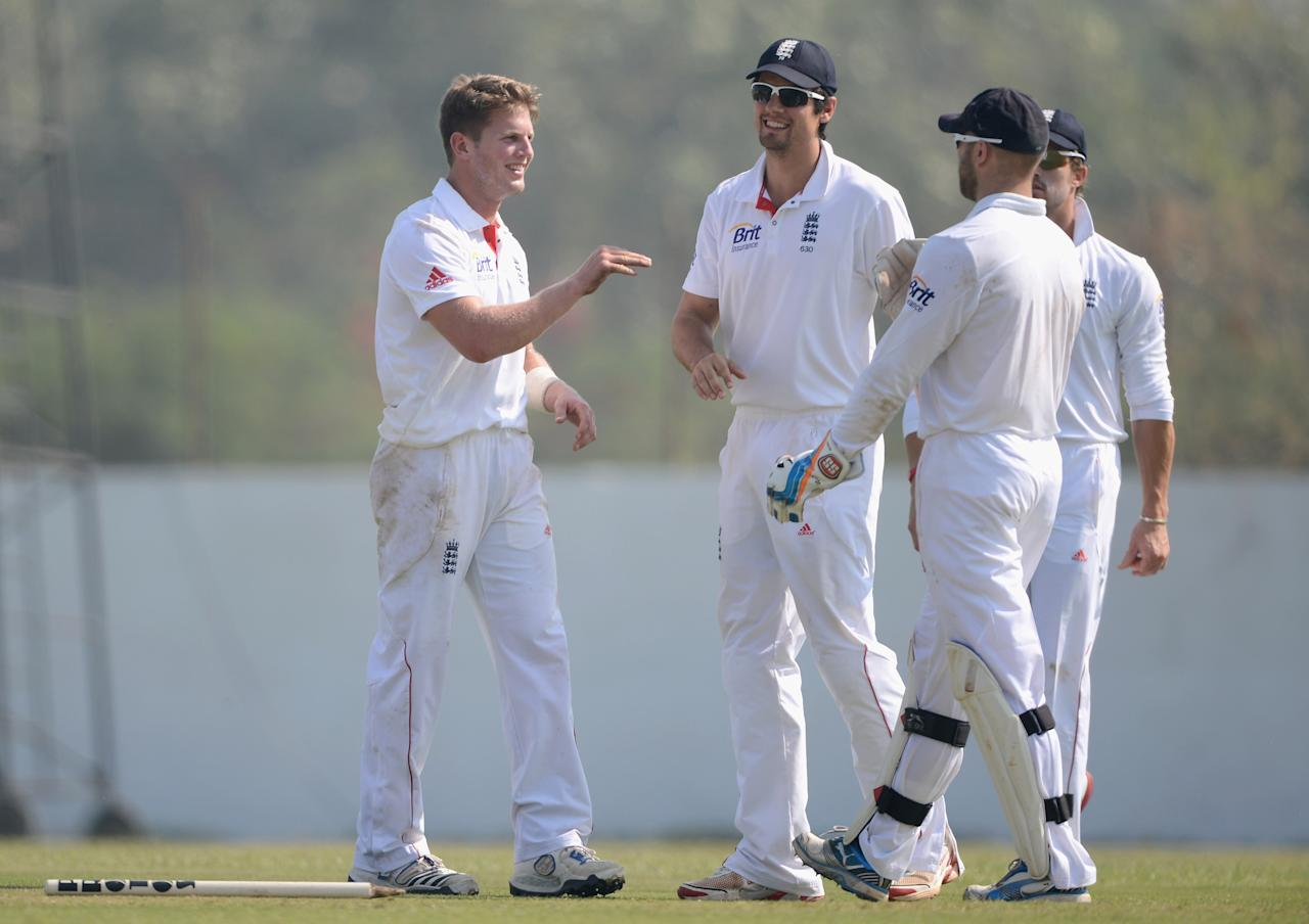 AHMEDABAD, INDIA - NOVEMBER 10:  Stuart Meaker of England celebrates with Alastair Cook after dismissing Jayant Yadav of Haryana during day three of the tour match between England and Haryana at Sardar Patel Stadium ground B on November 10, 2012 in Ahmedabad, India.  (Photo by Gareth Copley/Getty Images)