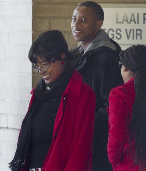 Winnie Madikizela-Mandela, former wife of former president Nelson Mandela, and unidentified family members leave the Mediclinic Heart Hospital where Nelson Mandela is being treated in Pretoria, South Africa Monday, June 17, 2013. In tweets, songs, telephone calls, cards and more, messages of love have come from across South Africa and the world for 94-year-old Nelson Mandela, giving the family comfort and hope as he remains hospitalized in serious condition with a lung infection, his wife Graca Machel said Monday. (AP Photo/Ben Curtis)