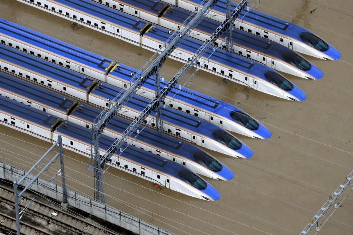 Bullet trains are seen submerged in muddy waters in Nagano, central Japan, after Typhoon Hagibis hit the city, Sunday, Oct. 13, 2019. Rescue efforts for people stranded in flooded areas are in full force after a powerful typhoon dashed heavy rainfall and winds through a widespread area of Japan, including Tokyo.(Yohei Kanasashi/Kyodo News via AP)