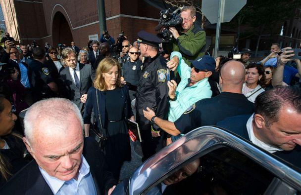 PHOTO: Actress Felicity Huffman, escorted by her husband William H. Macy, makes her way to a waiting SUV after leaving the courthouse in Boston, where she was sentenced for her role in the College Admissions scandal on September 13, 2019. (Joseph Prezioso/AFP/Getty Images)