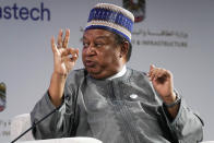 OPEC Secretary-General Mohammad Sanusi Barkindo gestures during a discussion on stage during the Gastech 2021 conference in Dubai, United Arab Emirates, Tuesday, Sept. 21, 2021. Energy officials from Qatar and Turkey, long-standing foes of the United Arab Emirates, descended on Dubai along with hundreds of other executives on Tuesday, flocking to the largest gas expo in the world and the industry's first in-person conference since the pandemic began. (AP Photo/Jon Gambrell)