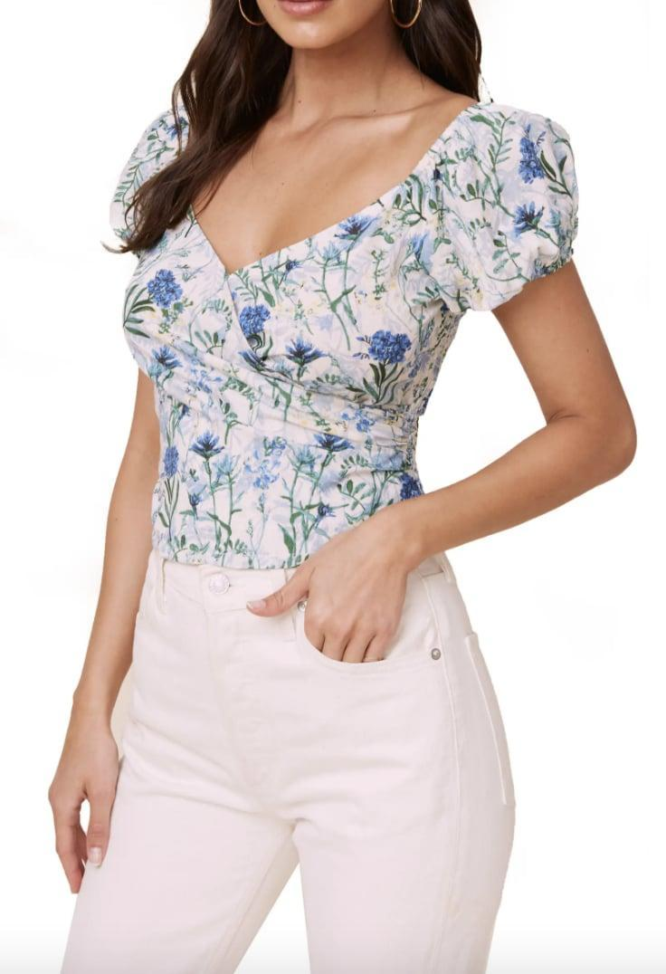 <p>You can wear this <span>ASTR the Label Floral Surplice Linen &amp; Cotton Crop Top</span> ($35, originally $59) to a fancy dinner date or out with girlfriends. </p>
