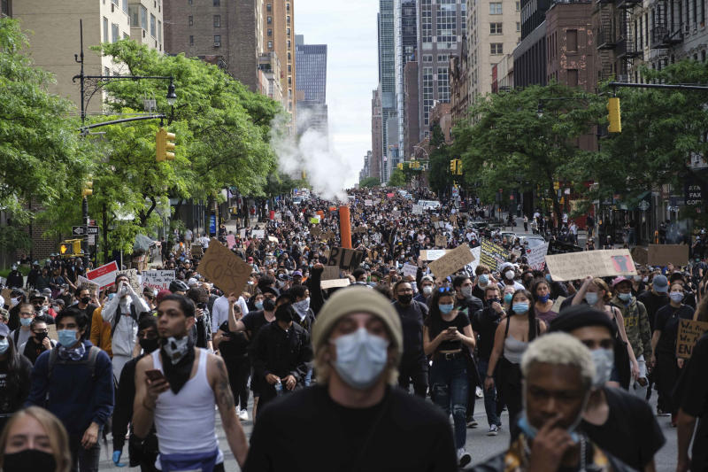 Protesters march through midtown New York as part of a demonstration Tuesday, June 2, 2020, in New York, to protest the death of George Floyd, who died May 25 after he was pinned at the neck by a Minneapolis police officer. (AP Photo/Yuki Iwamura)