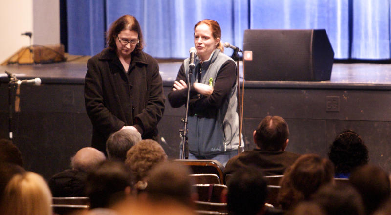 Aimee Tabor, mother of a Sandy Hook Elementary School student, speaks during a community meeting at the Newtown High school on the future of Sandy Hook Elementary School, in Newtown, Conn., Sunday, Jan. 13, 2013. Talk about Sandy Hook Elementary School is turning from last month's massacre to the future, with differing opinions on whether students and staff should ever return to the building where a gunman killed 20 students and six educators. Standing at right is Francis Pennorla, moderator. (AP Photo/Michelle McLoughlin, Pool)
