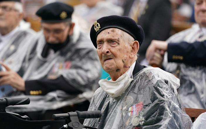 Veterans watch the official opening of the British Normandy Memorial in France via a live feed during a ceremony at the National Memorial Arboretum in Alrewas, Staffordshire - Jacob King/PA