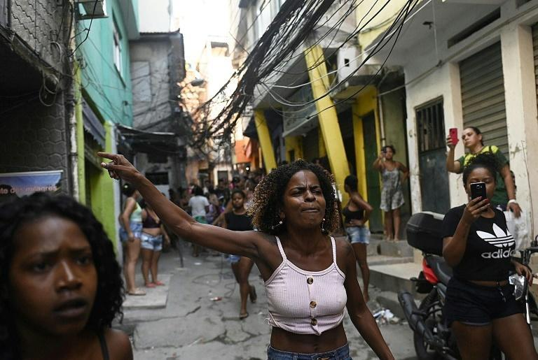Residents of the Jacarezinho favela in Rio de Janeiro protest after a police operation against alleged drug traffickers, with questions raised about the timing and justification for the raid