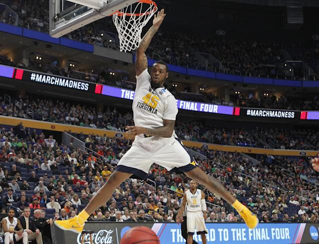 <p>West Virginia forward Elijah Macon (45) looses control of the ball during the second half of a first-round men's college basketball game in the NCAA Tournament against Bucknell, Thursday, March 16, 2017, in Buffalo, N.Y. (AP Photo/Jeffrey T. Barnes) </p>