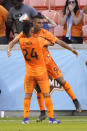 Houston Dynamo's Mauro Manotas (9) celebrates with Darwin Ceren (24) after scoring a goal against the Montreal Impact during the second half of an MLS soccer match Saturday, March 9, 2019, in Houston. (AP Photo/David J. Phillip)