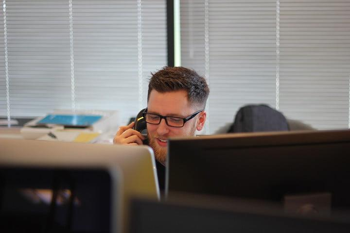 Person on a phone call at a desk