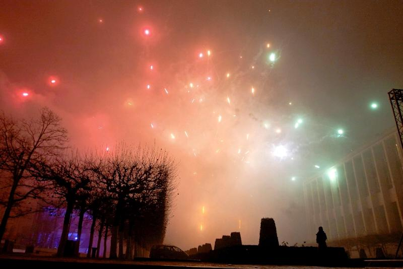 A person watches the fireworks in the center of Brussels on New Year's eve on December 31, 2010 (AFP Photo/Nicolas Maeterlinck)