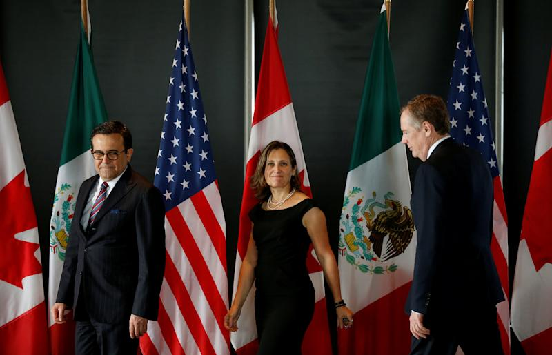 FILE PHOTO: Mexico's Economy Minister Guajardo, Canada's Foreign Minister Freeland and U.S. Trade Representative Lighthizer arrive for a meeting during the third round of NAFTA talks in Ottawa