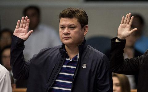 This file photo taken on September 7, 2017 shows Davao City Vice Mayor Paolo Duterte, son of Philippine President Rodrigo Duterte, taking an oath as he attends a senate hearing in Manila - Credit: AFP