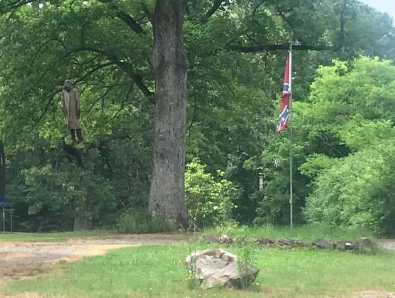 Neighbors furious after homeowners hang a Confederate flag and mannequin in their yard.