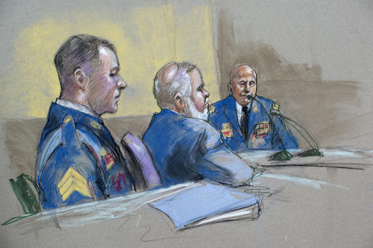 Army Sgt. Bowe Bergdahl, left, and defense lead counsel Eugene Fidell, center, look on as Maj. Gen. Kenneth Dahl is questioned during a preliminary hearing to determine if Sgt. Bergdahl will be court-martialed, Friday, Sept. 18, 2015, at Fort Sam Houston, Texas. Bergdahl, who left his post in Afghanistan and was held by the Taliban for five years, is charged with desertion and misbehavior before the enemy. (AP Photo/Brigitte Woosley)