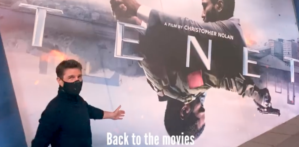 Cruise posed in front the Tenet poster. (Twitter/Tom Cruise)