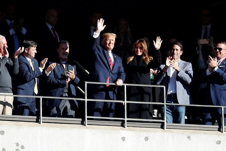 President Donald Trump and first lady Melania wave from their box at the football game between the LSU Tigers and Alabama Crimson Tide on November 09, 2019 in Tuscaloosa, Alabama (AFP Photo/Todd Kirkland)