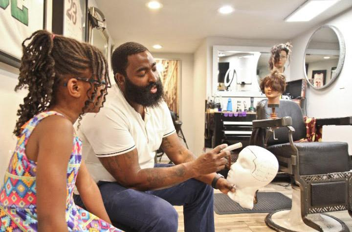 Neijae Graham-Henries: 8-year-old barber