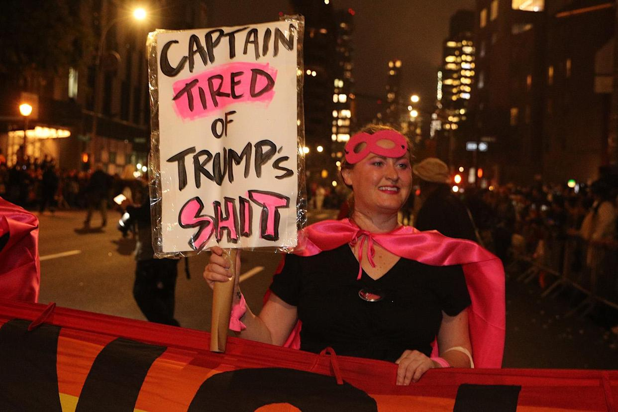A reveler from Gays Against Guns carries an anti-Trump sign while marching in the 46th annual Village Halloween Parade in New York City. (Photo: Gordon Donovan/Yahoo News)