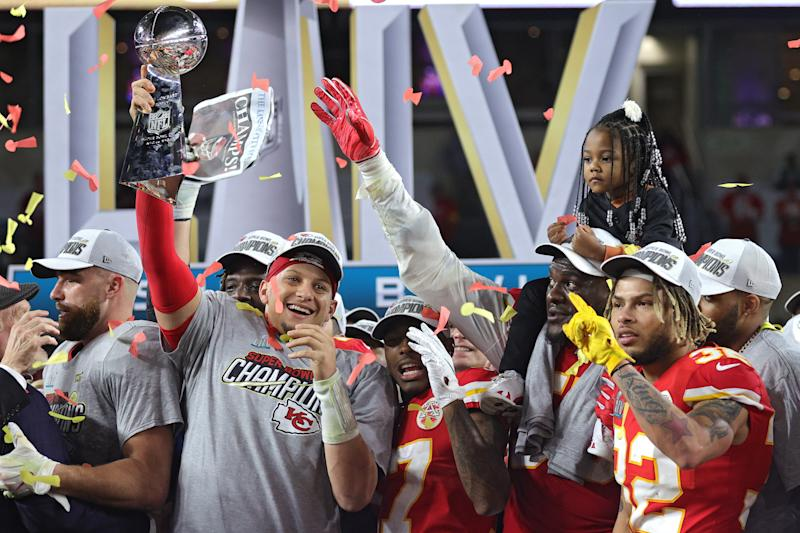 Patrick Mahomes raises the Vince Lombardi Trophy after defeating the San Francisco 49ers 31-20 in Super Bowl LIV. (Photo by Jamie Squire/Getty Images)