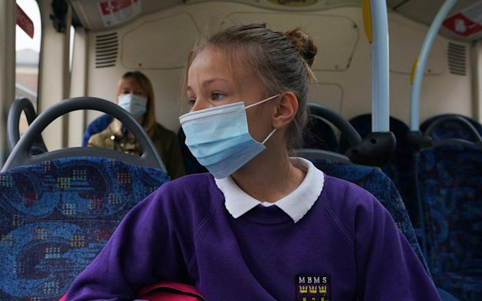 A school pupil wearing a face mask on a bus in Newcastle