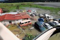 Car damaged by floods are seen near an area hit by a mudslide, caused by heavy rains brought by Storm Eta, as the search for victims continue in the buried village of Queja