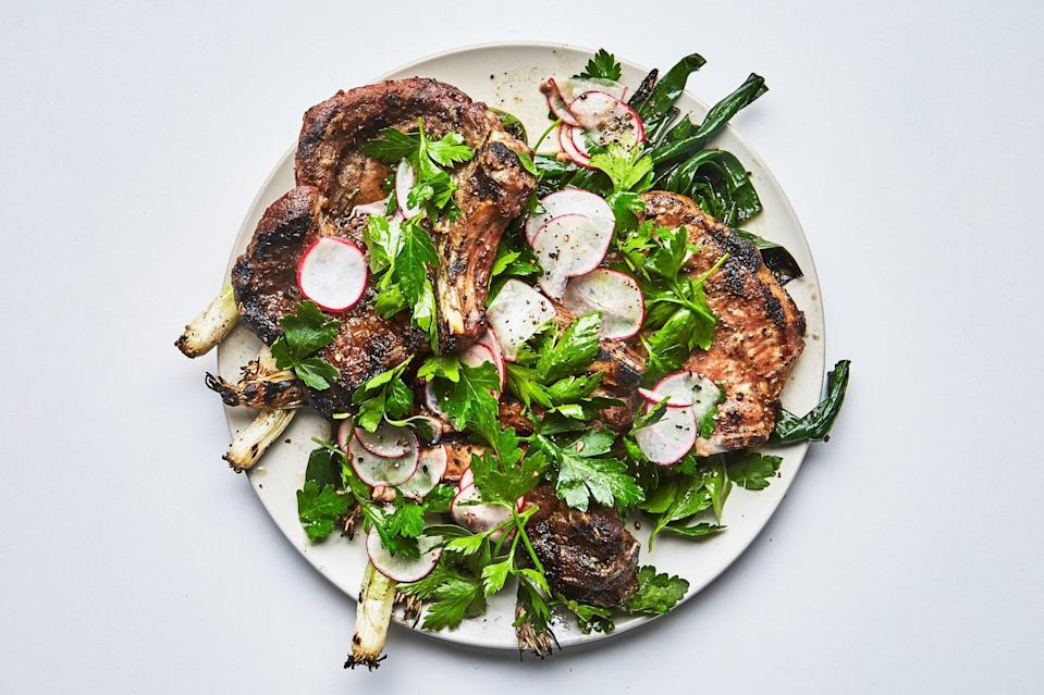 """A crisp, assertive salad of shaved radishes and parsley provides an addictive counterpoint to these fennel-rubbed, fire-kissed pork chops. <a href=""""https://www.epicurious.com/recipes/food/views/pork-chops-with-radishes-and-charred-scallions?mbid=synd_yahoo_rss"""" rel=""""nofollow noopener"""" target=""""_blank"""" data-ylk=""""slk:See recipe."""" class=""""link rapid-noclick-resp"""">See recipe.</a>"""