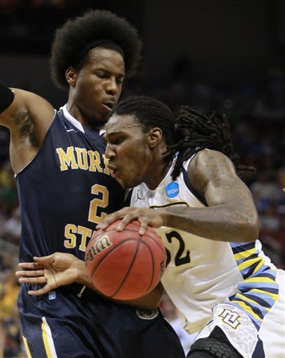 Marquette forward Jae Crowder (32) drives against Murray State forward Edward Daniel (2) in the first half of their NCAA third-round tournament college basketball game in Louisville, Ky., Saturday, March 17, 2012. (AP Photo/John Bazemore)