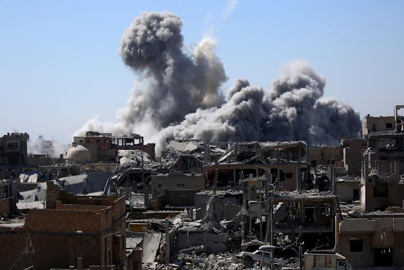 "Smoke billows in Raqqa on Sept. 3. ""Conditions in Raqqa are truly unthinkable ... it's hell on earth,"" says Dr. Homer Venters, director of programs at Physicians for Human Rights. (DELIL SOULEIMAN/AFP/Getty Images)"