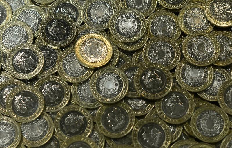 New two pound coins are seen at The Royal Mint, in Llantrisant