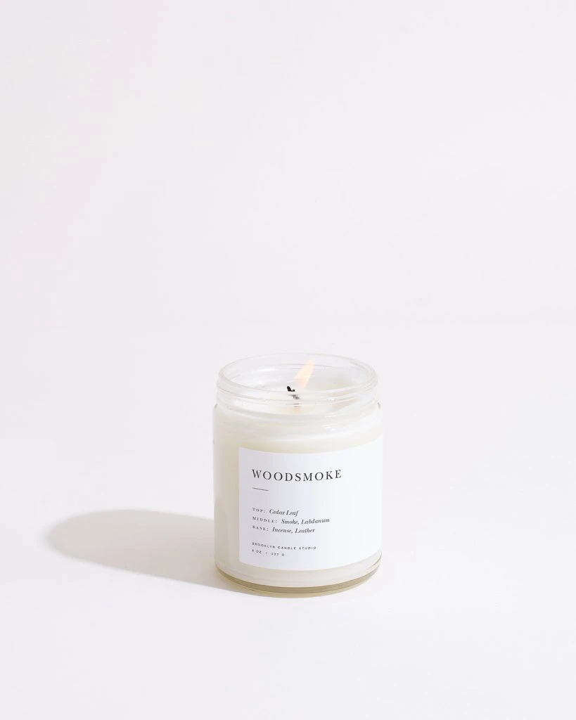 """<h3>Brooklyn Candle Studio Woodsmoke Minimalist Candle</h3><br>Described as a """"mini fireplace"""", this vegan and cruelty-free candle has notes of cedar leaf, labdanum, incense, and leather rounding out its rich smokiness.<br><br><strong>Brooklyn Candle Studio</strong> Woodsmoke Minimalist Candle, $, available at <a href=""""https://go.skimresources.com/?id=30283X879131&url=https%3A%2F%2Fbrooklyncandlestudio.com%2Fproducts%2Fwoodsmoke-minimalist-candle"""" rel=""""nofollow noopener"""" target=""""_blank"""" data-ylk=""""slk:Brooklyn Candle Studio"""" class=""""link rapid-noclick-resp"""">Brooklyn Candle Studio</a>"""