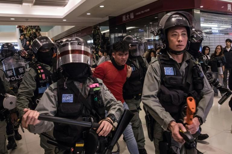 Riot police detain a man after a pro-democracy protest inside a shopping mall in Sheung Shui in Hong Kong in December 2019 (AFP Photo/DALE DE LA REY)