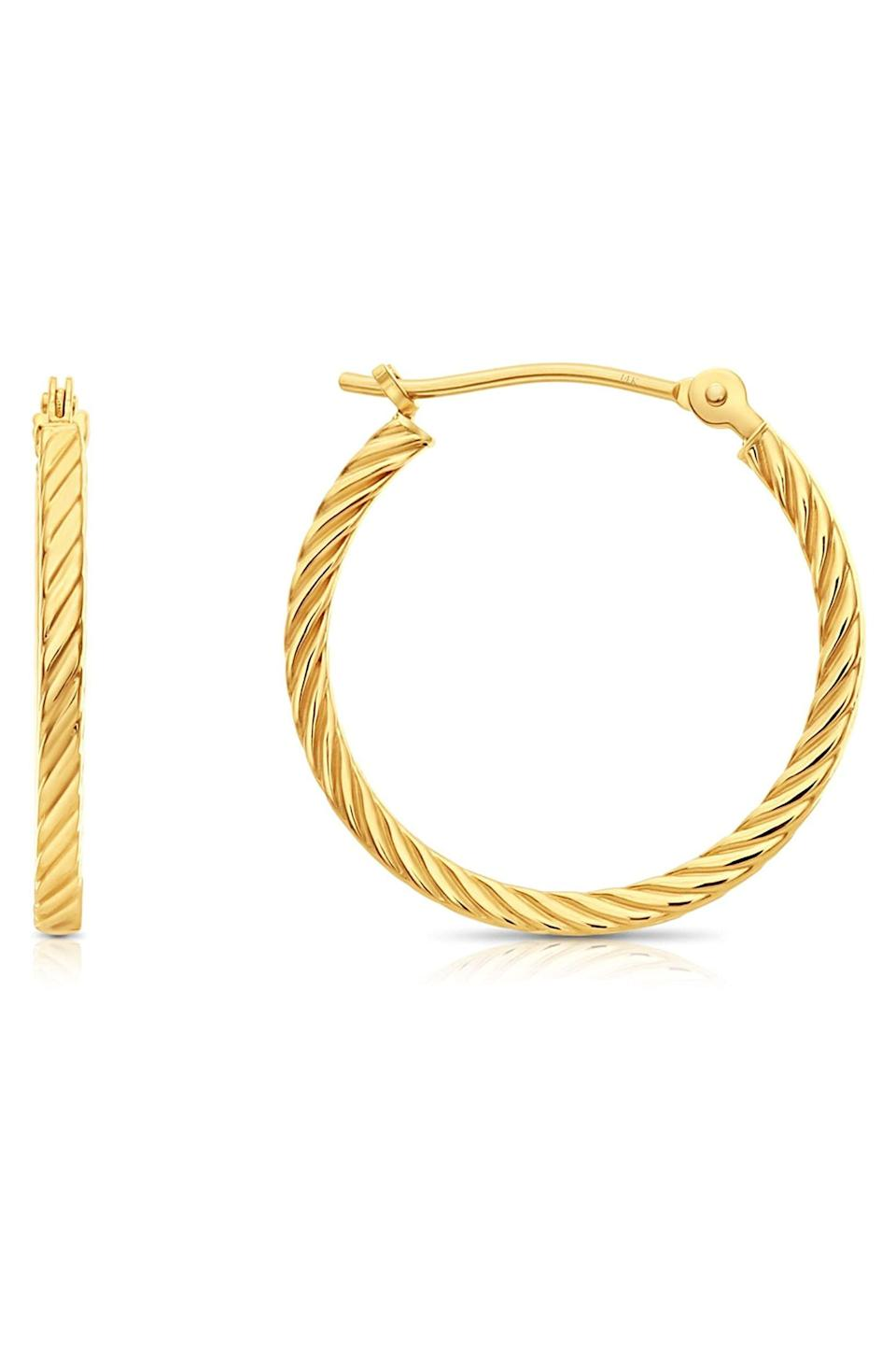 """<p><strong>Tilo Jewelry</strong></p><p>amazon.com</p><p><strong>$69.99</strong></p><p><a href=""""https://www.amazon.com/dp/B0821WQ9KF?tag=syn-yahoo-20&ascsubtag=%5Bartid%7C10063.g.34824549%5Bsrc%7Cyahoo-us"""" rel=""""nofollow noopener"""" target=""""_blank"""" data-ylk=""""slk:Shop Now"""" class=""""link rapid-noclick-resp"""">Shop Now</a></p><p>Gold hoops go with everything and somehow always feel cool wearing. Here, a 14k gold pair made in the US that won't slim down your holiday shopping budget. </p>"""