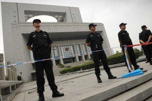 """Policemen stand guard outside the Intermediate People's Court in Hefei, Anhui province where four Chinese police officers are on trial in the Gu Kailai case. The wife of a former Chinese top politician at the heart of a scandal that has rocked the ruling Communist Party, has admitted murdering a British businessman and blamed her actions on a """"mental breakdown,"""" according to state media"""